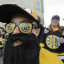 Dayton King of Langley, British Columbia, wears Boston Bruins glasses and a hockey playoff beard outside TD Garden before Game 4 of the NHL hockey Stanley Cup Finals between the Bruins and the Chicago Blackhawks in Boston, Wednesday, June 19, 2013. (AP Photo/Charles Krupa)
