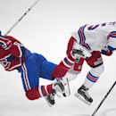 Montreal Canadiens' David Desharnais, left, collides with New York Rangers' Derek Dorsett during the first period of an NHL hockey game, Saturday, April 12, 2014, in Montreal The Associated Press