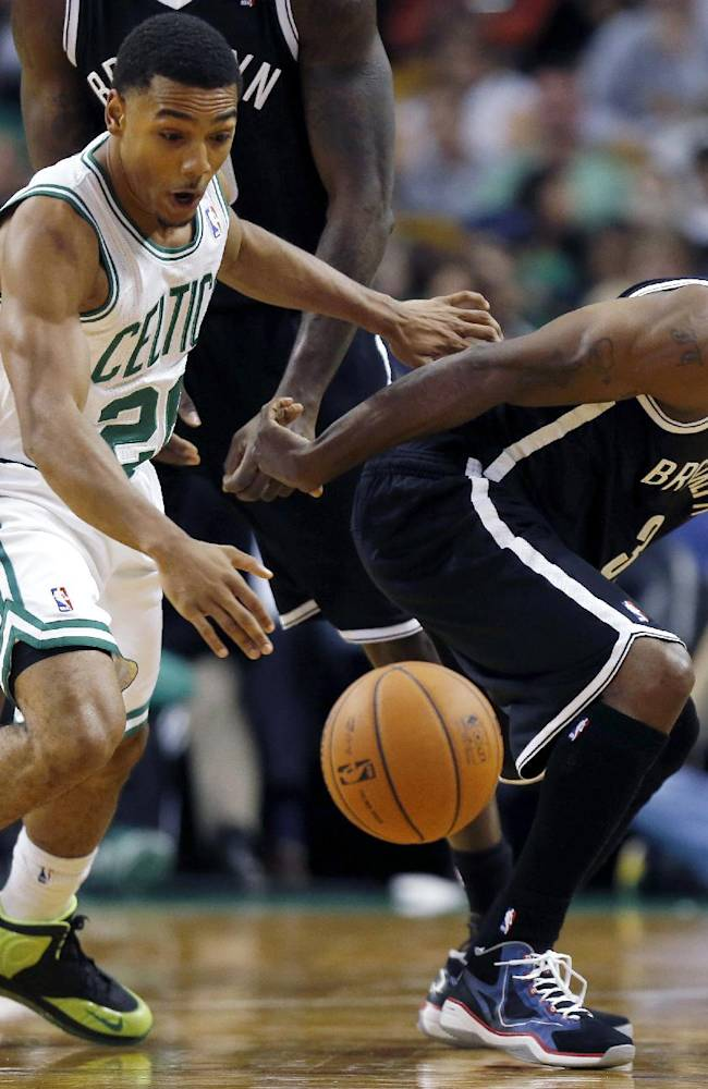 Boston Celtics' Phil Pressey (26) and Brooklyn Nets' Jason Terry (31) battle for a loose ball in the second quarter of a preseason NBA basketball game in Boston, Wednesday, Oct. 23, 2013