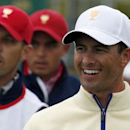 International team member Adam Scott (R) of Australia smiles as he walks ahead of U.S team member Rickie Fowler (C) on the first hole during their singles matches of the 2015 Presidents Cup golf tournament at the Jack Nicklaus Golf Club in Incheon, South Korea, October 11, 2015. REUTERS/Toru Hanai