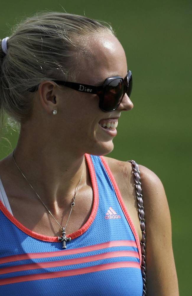 Rory McIlroy's girlfriend Caroline Wozniacki watches him play during the 2nd round of DP World Golf Championship in Dubai, United Arab Emirates, Friday, Nov. 15, 2013