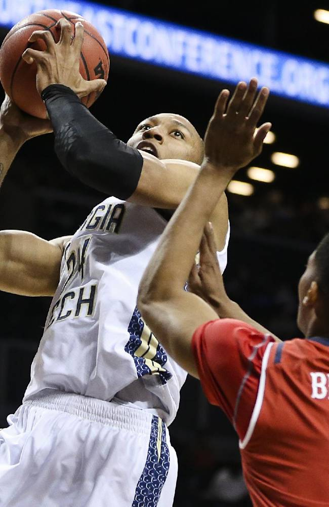Georgia Tech forward Kammeon Holsey (24) shoots against St. John's guard Jamal Branch (0) in the first half of their NCAA college basketball game, the consolation game of the Barclays Center Classic, Saturday, Nov. 30, 2013, in New York