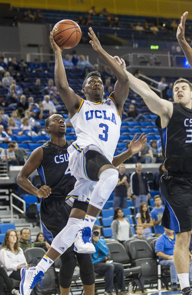 UCLA's Jordan Adams (3) goes up for a layup against Cal State San Bernardino in the second half of an NCAA college exhibition  basketball game on Wednesday, Oct. 30, 2013, in Los Angeles