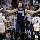 Charlotte Bobcats' Josh McRoberts (11) reacts after being called for a foul during the second half in Game 2 of an opening-round NBA basketball playoff series against the Miami Heat, Wednesday, April 23, 2014, in Miami. The Heat defeated the Bobcats 101-97. (AP Photo/Lynne Sladky)