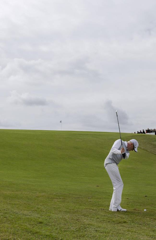 Britain's Simon Dyson plays the ball on the 15th hole in the final round of the KLM Open men's golf tournament in the beach resort of Zandvoort, western Netherlands, Sunday, Sept. 15, 2013