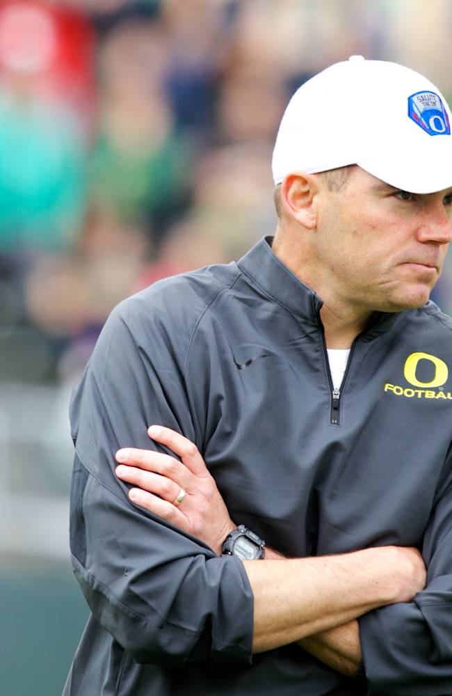 Oregon coach Mark Helfrich coaches during the Ducks spring NCAA college football game on Saturday, May 3, 2014, at Autzen Stadium in Eugene, Ore