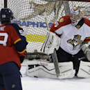 In this Monday, Sept. 21, 2014, photo, Florida Panthers goalie Al Montoya, right, defends a shot on the goal by Jonathan Racine (58) during hockey training camp, in Coral Springs, Fla. The franchise that hasn't won a playoff series since 1996 is once agai