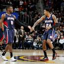 CLEVELAND, OH - DECEMBER 17: Shelvin Mack #8 and Kent Bazemore #24 of the Atlanta Hawks celebrate during a game against the Cleveland Cavaliers at The Quicken Loans Arena on December 17, 2014 in Cleveland, Ohio. (Photo by Gregory Shamus/NBAE via Getty Images)