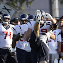Houston Texans defensive end J.J. Watt stretches with teammates during an NFL football training camp practice Thursday, Aug. 14, 2014, in Houston The Associated Press