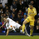 Tottenham s Kyle Naughton, left, competes for the ball with FC Sheriff s Ricardinho during the Europa League Group K soccer match between Tottenham Hotspur and FC Sheriff at White Hart Lane stadium, London, Thursday, Nov. 7, 2013