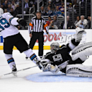 Los Angeles Kings goalie Jonathan Quick, right, tangles with San Jose Sharks center Logan Couture during the third period in Game 3 of an NHL hockey first-round playoff series, Tuesday, April 22, 2014, in Los Angeles The Associated Press