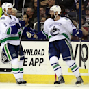 Vancouver Canucks' Chris Higgins, right, celebrates his goal against the Columbus Blue Jackets with teammate Kevin Bieksa during the second period of an NHL hockey game in Columbus, Ohio, Friday, Nov. 28, 2014. Vancouver won 5-0 The Associated Press