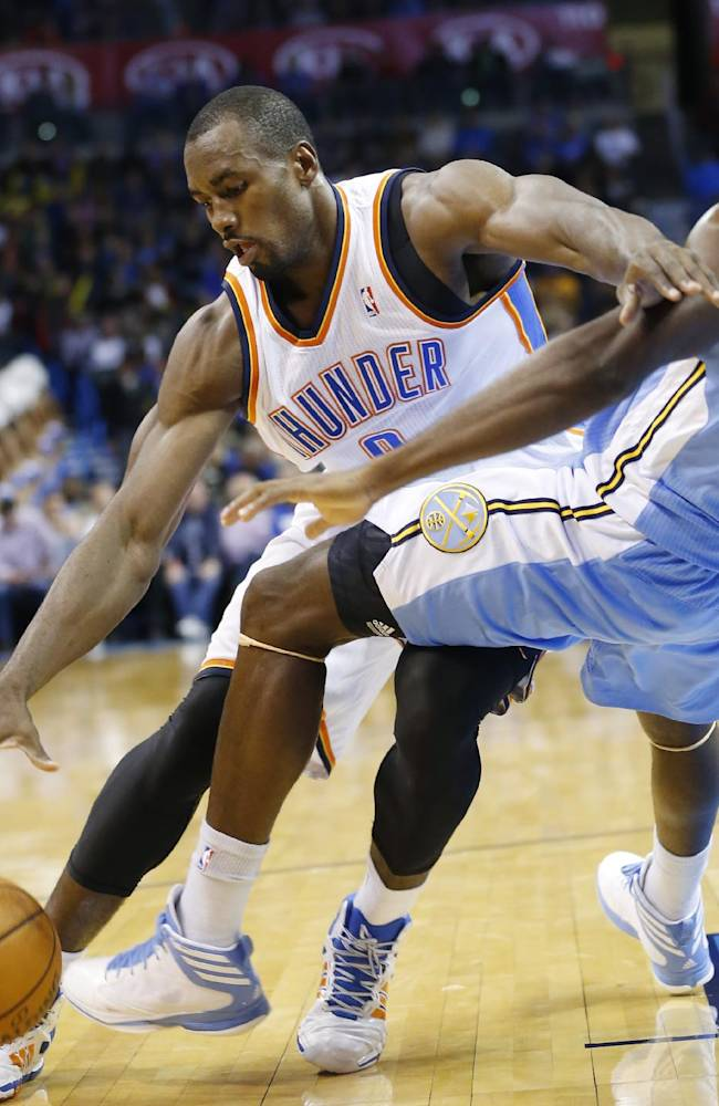 Denver Nuggets forward Kenneth Faried (35) falls after fouling Oklahoma City Thunder forward Serge Ibaka (9) in the first quarter of a preseason NBA basketball game in Oklahoma City, Tuesday, Oct. 15, 2013