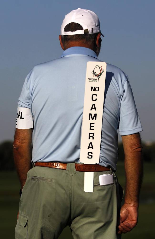 A marshall stands by the 12th hole during the first round of the Portugal Master golf tournament at the Victoria golf course in Vilamoura, southern Portugal, Thursday, Oct. 10, 2013