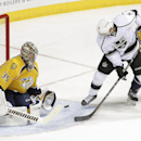 Los Angeles Kings defenseman Jamie McBain (5) scores a goal against Nashville Predators goalie Pekka Rinne (35), of Finland, in the first period of an NHL hockey game Tuesday, Nov. 25, 2014, in Nashville, Tenn. At right is Predators center Craig Smith (15
