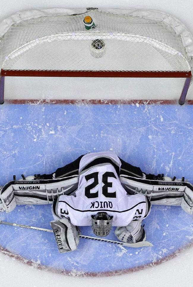 Los Angeles Kings' Jonathan Quick stretches before the start of the second period of an NHL hockey game against the Philadelphia Flyers, Monday, March 24, 2014, in Philadelphia