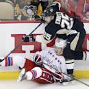 Pittsburgh Penguins' Andrew Ebbett (25) collides with Washington Capitals' Andre Burakovsky (65) during the first period of an NHL hockey game in Pittsburgh, Saturday, Dec. 27, 2014. (AP Photo/Gene J. Puskar)