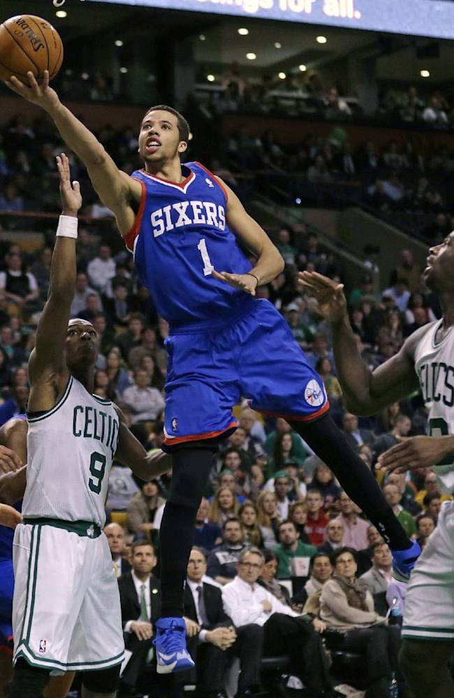 Philadelphia 76ers guard Michael Carter-Williams (1) drives through the Boston Celtics for a basket during the second half of an NBA basketball game Friday, April 4, 2014, in Boston. Carter-Williams had 24 points in the 76ers' 111-102 win