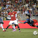 From left, Los Angeles Galaxy's Kofi Opare, Manchester United's Nani and Galaxy goalkeeper Brain Rowe watch a shot by Shinji Kagawa during the second half of a friendly soccer match at the Rose Bowl on Wednesday, July 23, 2014, in Pasadena, Calif. The Man