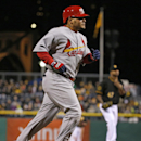 St. Louis Cardinals' Yadier Molina rounds third after hitting a solo home run off Pittsburgh Pirates starting pitcher Francisco Liriano, rear, during the sixth inning of a baseball game in Pittsburgh on Saturday, April 5, 2014 The Associated Press