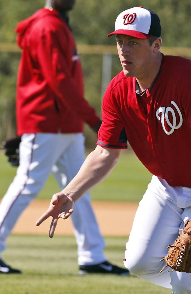 Washington Nationals starting pitcher Jordan Zimmermann makes a toss to home during a spring training baseball workout, Monday, Feb. 17, 2014, in Viera, Fla