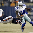 Dallas Cowboys wide receiver Dez Bryant (88) goes out as Chicago Bears inside linebacker Jon Bostic (57) tries to tackle him during the first half of an NFL football game Thursday, Dec. 4, 2014, in Chicago The Associated Press