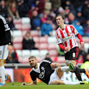 Sunderland's Craig Gardner, right, celebrates his goal during their English FA Cup fifth round soccer match against Southampton at the Stadium of Light, Sunderland, England, Saturday, Feb. 15, 2014