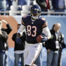 In this Sunday, Nov. 10, 2013 file photo, Chicago Bears tight end Martellus Bennett (83) warms up before an NFL football game against the Detroit Lions, in Chicago. Through the first quarter of the fantasy football season, some surprising names have topp