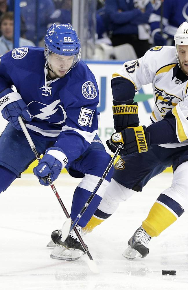 Tampa Bay Lightning right wing Nikita Kucherov (56), of Russia, battles with Nashville Predators left wing Richard Clune (16) for the puck during the second period of an NHL hockey game, Thursday, Dec. 19, 2013, in Tampa, Fla