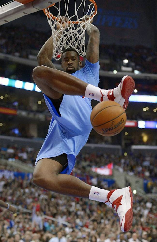 Los Angeles Clippers center DeAndre Jordan dunks during the second half of an NBA basketball game against the Indiana Pacers, Sunday, Dec. 1, 2013, in Los Angeles