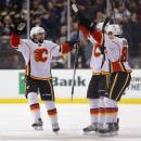 BOSTON, MA - MARCH 05:  David Schlemko #3 of the Calgary Flames is congratulated by teammates after scoring the game winning goal during a shootout against the Boston Bruins at TD Garden on March 5, 2015 in Boston, Massachusetts. The Flames defeat the Bruins 4-3.  (Photo by Maddie Meyer/Getty Images)