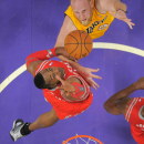Houston Rockets center Dwight Howard, below, jumps to block the shot of Los Angeles Lakers center Chris Kaman during the first half of an NBA basketball game, Wednesday, Feb. 19, 2014, in Los Angeles The Associated Press