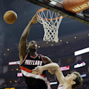 Portland Trail Blazers' Thomas Robinson tries to shoot past Houston Rockets' Omer Asik during the first half in Game 1 of an opening-round NBA basketball playoff series, Sunday, April 20, 2014, in Houston The Associated Press