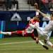 Portland Timbers' Ryan Johnson, left, of Jamaica, reaches for the ball off a pass as Vancouver Whitecaps' Jordan Harvey defends during the first half of an MLS soccer game in Vancouver, British Columbia on Saturday, May 18, 2013