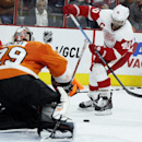Philadelphia Flyers' Ray Emery (29), left, defends the goal as Detroit Red Wings' Henrik Zetterberg (40) tries to get a shot off in the third period of an NHL hockey game Saturday, Oct. 25, 2014, in Philadelphia. The Flyers won 4-2 The Associated Press
