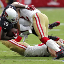 Arizona Cardinals wide receiver Ted Ginn Jr. (19) is hit by San Francisco 49ers cornerback Chris Cook (22) during the first half of an NFL football game, Sunday, Sept. 21, 2014, in Glendale, Ariz The Associated Press