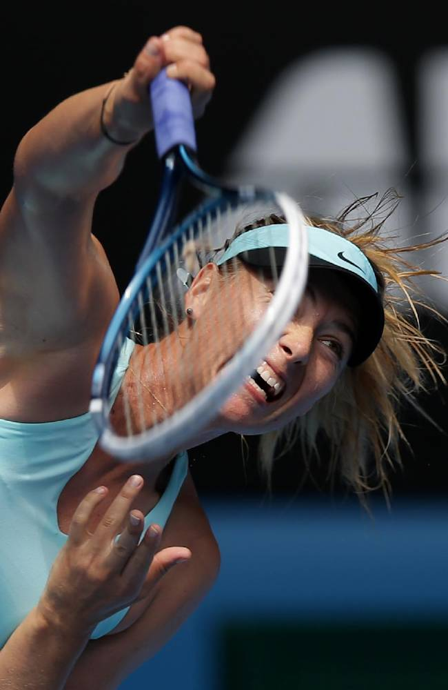 Maria Sharapova of Russia serves to Alize Cornet of France during their third round match at the Australian Open tennis championship in Melbourne, Australia, Saturday, Jan. 18, 2014