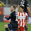 Manchester United's Wayne Rooney reacts to the referee's decision as Nelson Valdez looks on during their Champions League, round of 16, first leg soccer match at Georgios Karaiskakis stadium, in Piraeus port, near Athens, on Tuesday, Feb. 25, 2014. Olympi