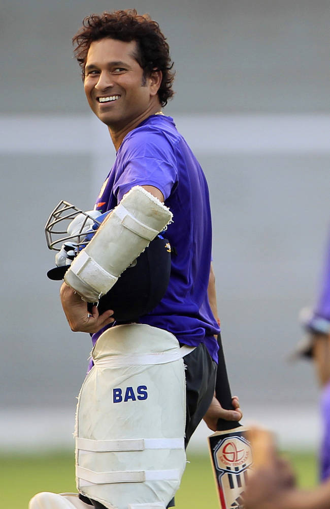 In this Nov. 9, 2012 file photo, India's Sachin Tendulkar smiles as he walks to the pavilion after a practice session in Mumbai, India. Tendulkar, the most prolific batsman in international cricket history plays his 200th and last test for India against West Indies from Thursday, Nov. 14