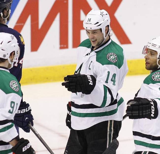 Dallas Stars' Tyler Seguin (91) celebrates his goal with teammates Jamie Benn (14) and Trevor Daley (6) during the second period of an NHL hockey game against the Florida Panthers in Sunrise, Fla., Sunday, April 6, 2014