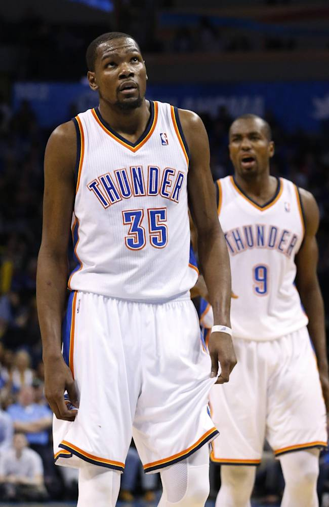 Oklahoma City Thunder forward Kevin Durant (35) prepares to take a foul shot in the fourth quarter of an NBA basketball game against the Detroit Pistons in Oklahoma City, Wednesday, April 16, 2014. Thunder forward Serge Ibaka is at right. Oklahoma City won 112-111