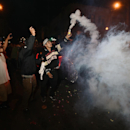 San Francisco Giants fans celebrate in the Mission district after the San Francisco Giants beat the Kansas City Royals to win the World Series on Wednesday, Oct. 29, 2014, in San Francisco. (AP Photo/Noah Berger)