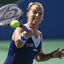 Dominika Cibulkova from Slovakia returns a shot to Donna Vekic from Croatia in the singles final match of the WTA BMW Malaysian Open 2014 at Royal Selangor Golf Club in Kuala Lumpur, Malaysia, Sunday April 20, 2014. (AP Photo)