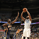 CHARLOTTE, NC - MARCH 5: Al Jefferson #25 of the Charlotte Bobcats shoots against Roy Hibbert #55 of the Indiana Pacers during the game at the Time Warner Cable Arena on March 5, 2014 in Charlotte, North Carolina. (Photo by Kent Smith/NBAE via Getty Images)