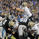 New Orleans Saints' Drew Brees (9) dives over the goal line for a touchdown against the Carolina Panthers in the second half of an NFL football game in Charlotte, N.C., Thursday, Oct. 30, 2014 The Associated Press