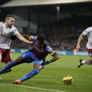 Crystal Palace's Wilfried Zaha, center, competes for the ball with Aston Villa's Tom Cleverley, left, and Ciaran Clark, right, during the English Premier League soccer match between Crystal Palace and Aston Villa at Selhurst Park stadium in London, Tuesda