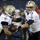 New Orleans Saints quarterback Drew Brees (9) hands off the ball to New Orleans Saints running back Mark Ingram (22) during the warm up before an NFL football game against the Chicago Bears Monday, Dec. 15, 2014, in Chicago The Associated Press