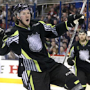 Team Foligno's Ryan Johansen of the Columbus Blue Jackets celebrates the first of his two first-period goals against Team Toews' goalie Roberto Luongo of the Florida Panthers during the NHL All-Star hockey game in Columbus, Ohio, Sunday, Jan. 25, 2015 The