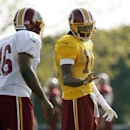 Washington Redskins quarterback Robert Griffin III, right, talks with running back Alfred Morris during practice at the team's NFL football training facility, Saturday, July 26, 2014 in Richmond, Va The Associated Press