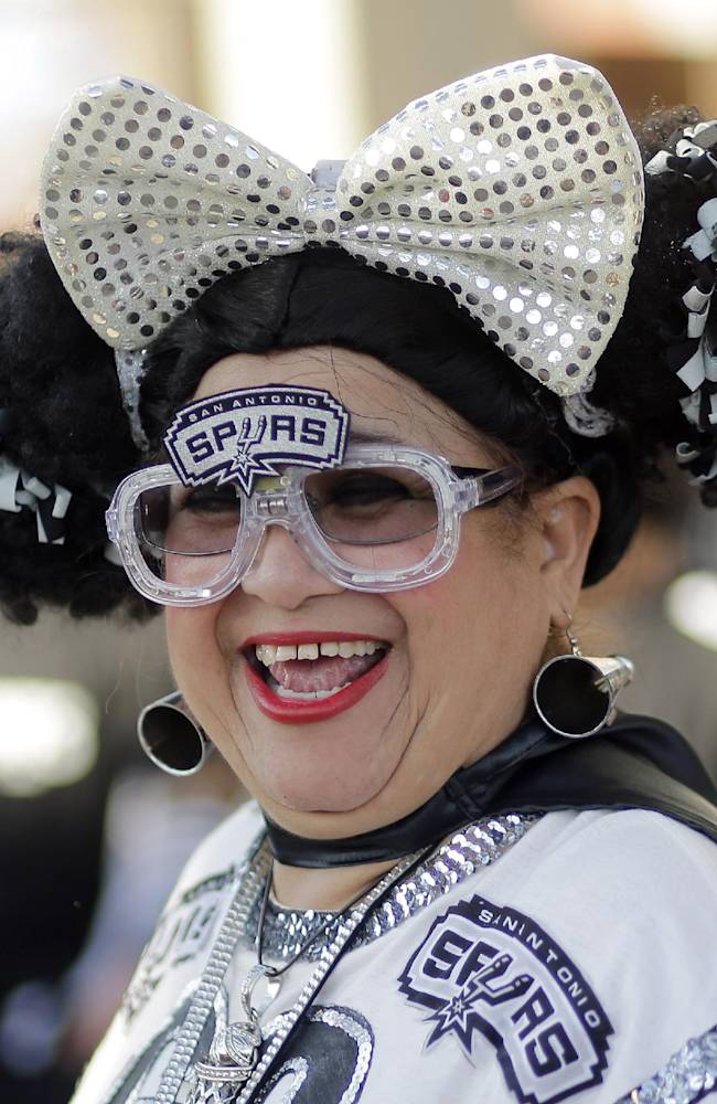 San Antonio Spurs fan Sovia Lauflano dances outside the AT&T Center prior to Game 5 of a Western Conference finals NBA basketball playoff series between the Spurs and the Oklahoma City Thunder, Thursday, May 29, 2014, in San Antonio